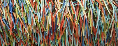 A Rainbow of Colorful Strands of Ribbons and Threads. A handcrafted fabric which creates a rainbow of colorful ribbons on woven fabric Stock Image