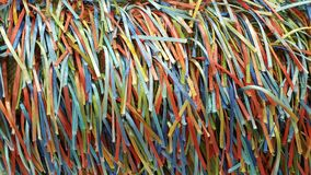 A Rainbow of Colorful Strands of Ribbons and Threads. A handcrafted fabric which creates a rainbow of colorful ribbons on woven fabric Royalty Free Stock Image