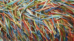 A Rainbow of Colorful Strands of Ribbons and Threads. A handcrafted fabric which creates a rainbow of colorful ribbons on woven fabric Stock Photography
