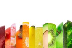 Rainbow colorful fruit stripe collection isolated on white background. Rainbow colorful tropical fruit stripe collection isolated on white background with copy stock photos