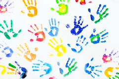 Rainbow colors arm prints abstract. On white background Royalty Free Stock Photo