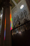 Rainbow colors on column in Madrid cathedral Stock Image