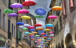 Hundreds of colorful umbrellas hanging from the wire. The rainbow colors in flight for freedom stock illustration