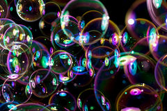 Rainbow colors of flying soap bubbles Royalty Free Stock Images