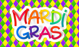 Rainbow colors Mardi Gras lettering sign on traditional carnival pattern. Rainbow colors vector Mardi Gras lettering sign on traditional carnival pattern Stock Photo