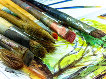 Rainbow colors of oil paints and brush. Rainbow colors of oil paints and vintage brush Stock Images
