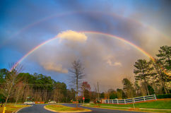Rainbow colors over country roads Stock Images