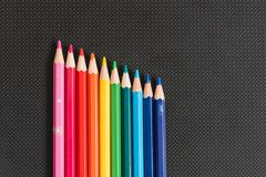 Rainbow colors pencils close up. Isolated on black background Royalty Free Stock Photo