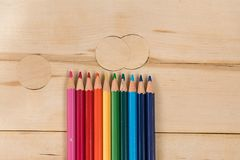 Rainbow colors pencils close up. Isolated on wooden background Stock Photos