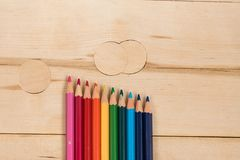 Rainbow colors pencils close up. Isolated on wooden background Royalty Free Stock Images