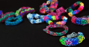 Rainbow colors rubber bands loom bracelets Stock Photography