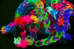 Rainbow colors rubber bands loom bracelets Stock Photos