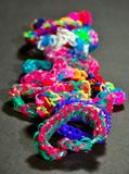 Rainbow colors rubber bands loom bracelets Royalty Free Stock Photos