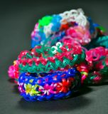 Rainbow colors rubber bands loom bracelets Royalty Free Stock Photo