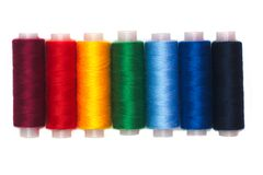 Rainbow colors thread spools isolated Royalty Free Stock Photo