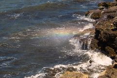 Rainbow colors the water spray Stock Photography