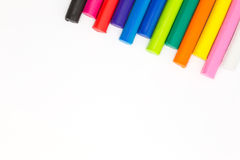 Rainbow colour of art clay sticks on right coner of white background Royalty Free Stock Photography