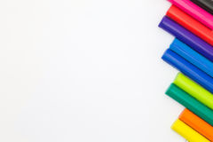 Rainbow colour of art clay sticks on right side of white background Stock Photos