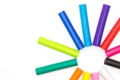 Rainbow colour of art clay sticks on white background Stock Image