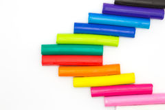 Rainbow colour children's plasticine sticks Royalty Free Stock Photos
