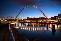 Rainbow Coloured Bridge. Evening on the Tyne. The Gateshead Millennium Bridge lit with multi coloured spotlights Stock Image