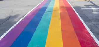 Rainbow coloured crosswalk for Pride Month on Church street in Toronto. In support of the LGBTQ+ community stock photos