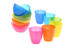 Rainbow-coloured glasses and bowls isolated Stock Image