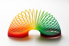 Rainbow coloured slinky toy Stock Photo