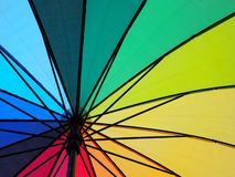 Rainbow coloured umbrella details close up. Colorful, bright, shelter, summer, vacation, sun, sunrays stock photography