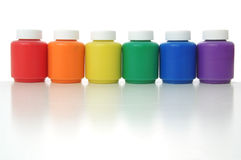 Rainbow colours. Six coloured paint boxes, standing one by one as a colours of rainbow Royalty Free Stock Photography