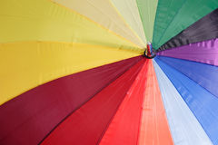 Rainbow Colours. Close up of a rainbow coloured umbrella Stock Image
