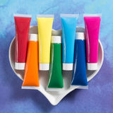Rainbow colours heart - multicolored acrylic paints tubes set. Rainbow colours heart - multicolored rainbow acrylic paints tubes set, happy colorful world Royalty Free Stock Images
