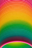 Rainbow colours of a plastic slinky toy. Closeup of the graduated rainbow colours of a vintage spiral coiled plastic slinky toy in the form of a spring Royalty Free Stock Photography