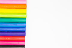 Rainbow colours plasticine play dough modeliing clay on conner of white background Royalty Free Stock Photo