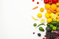 Rainbow composition with fresh vegetables. And fruits on white background, flat lay stock photography