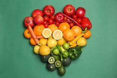 Rainbow composition with ripe fruits and vegetables. On color background, top view stock photography