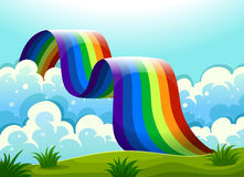 A rainbow connecting the sky and the hill. Illustration of a rainbow connecting the sky and the hill Stock Images