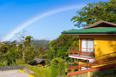 Rainbow in costa rica in sumer. Rainbow in costa rica view from house`s  garden in summer Stock Photography