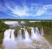 The rainbow costs over water streams. Stock Image