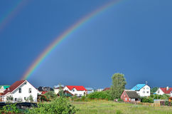 Rainbow in the countryside Royalty Free Stock Image