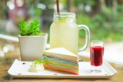 Rainbow crapecake set in the morning. Rainbow cake and honey lemon drink Royalty Free Stock Photography