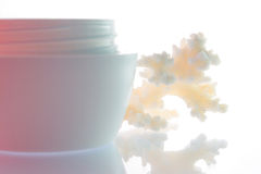 Rainbow cream. Coral and a jar of cream Royalty Free Stock Photography