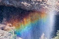 Rainbow created by the water of Phantom Waterfall dropping off over vertical basalt walls, North Table Mountain Ecological Reserve. Oroville, California royalty free stock images