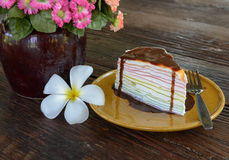 Rainbow crepe cake and chocolate on top. Royalty Free Stock Photo
