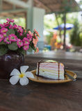 Rainbow crepe cake and chocolate on top. Royalty Free Stock Photos