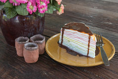 Rainbow crepe cake and chocolate on top. Stock Images