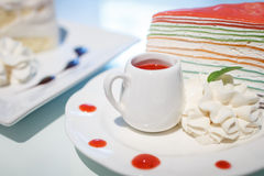 Rainbow crepe cake with a cup of strawberry juice Stock Photography