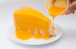 Rainbow crepe cake. With orange jam Stock Image