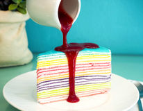 Rainbow Crepe Cake with strawberry sauce Royalty Free Stock Photography