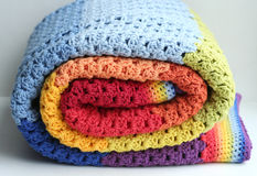 Rainbow crocheted blanket Stock Image